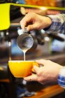 Barista making cup of espresso — Stock Photo