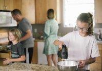 Family preparing breakfast — Stock Photo