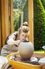 Woman potter measuring a pot — Stock Photo