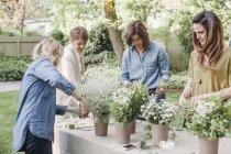 Women making a flower wreath. — Stock Photo