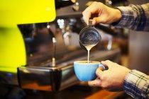 Barista making cup of espresso — Stock Photo