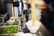 Chef preparing bowls of ramen noodles — Stock Photo