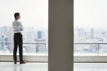 Businessman in the office standing by window — Stock Photo