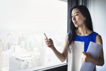 Businesswoman using smart phone. — Stock Photo