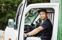 Man sitting in a truck — Stock Photo