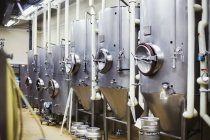 Metal beer tanks in a brewery. — Stock Photo