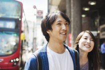 Young man and woman on street — Stock Photo