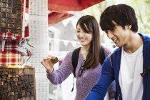 Two Japanese tourist shopping — Stock Photo