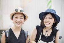 Young women wearing hats. — Stock Photo