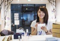 Saleswoman selling Edo Kiriko cut glass — Stock Photo