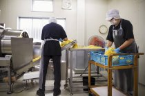 Workers in a factory producing Soba noodles, — Stock Photo