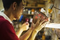 Craftsman in a glass maker's workshop — Stock Photo
