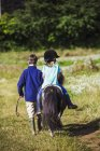 Girl riding a pony — Stock Photo