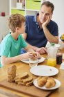 Father and son at breakfast table. — Stock Photo