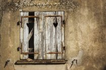 Broken wooden shutters. — Stock Photo