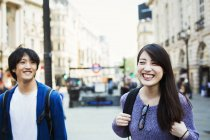 Japanese man and woman near Piccadilly Circus. — Stock Photo