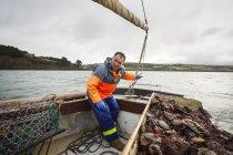 Fisherman on sailing boat — Stock Photo
