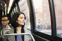 Woman sitting on train and looking out of window — Stock Photo