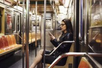 Woman sitting in subway carriage — Stock Photo