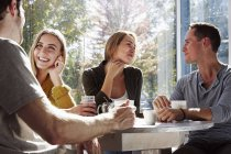 People sitting at cafe — Stock Photo