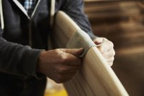 Surfboard maker at work — Stock Photo