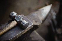 Hammer and small anvil — Stock Photo
