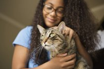 Girl with pet cat on lap — Stock Photo