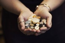 Woman holding hands full of buttons — Stock Photo