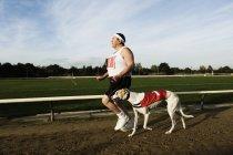 Man in sportswear standing on racetrack — Stock Photo