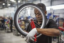 Worker assembling bicycle — Stock Photo
