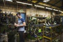 Man standing in shoemaker's workshop — Stock Photo