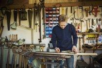 Man standing in garden workshop — Stock Photo