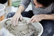 Man shaping clay pot — Stock Photo