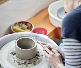 Person using a pottery wheel — Stock Photo