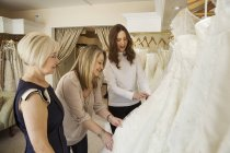 Women in wedding dress shop — Stock Photo