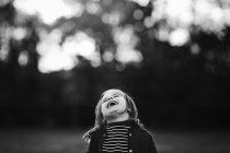 Girl throwing head back and laughing. — Stock Photo