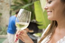 Woman holding glass of wine — Stock Photo
