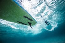 Paddleboard taken underwater. — Stock Photo