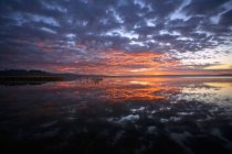 Sunset sky reflecting on lake surface in Canada — Stock Photo