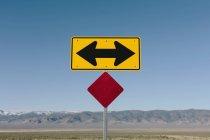 Directional arrow sign along rural road near Orovada, Nevada, USA. — Stock Photo