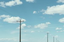Telephone poles, power lines and cloudy sky — Stock Photo
