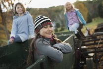 Elementary age girls hanging out in old trailer. — Stock Photo