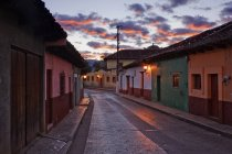 Empty town street at dawn under dramatic sky, Chiapas, Mexico — Stock Photo