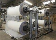 Loom reels in factory interior, Nikologory, Russia — Stock Photo
