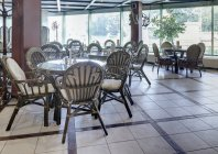 Spacious cafe with rattan furniture, Moscow, Russia — Stock Photo