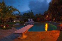 Tropical backyard pool at night, Hawaii, USA — Stock Photo