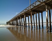 Low angle view of boardwalk in Cayucos, California, USA — Stock Photo