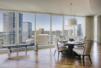 Dining room of luxury highrise apartment — Stock Photo