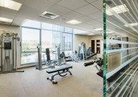 Empty weight room in modern apartment building — Stock Photo