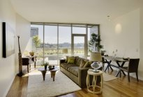 Living room in luxury highrise apartment — Stock Photo